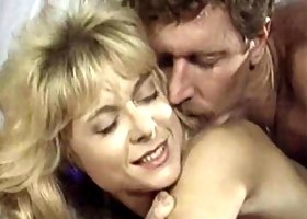 Busty sporty blonde babe gets feverishly fucked in bed