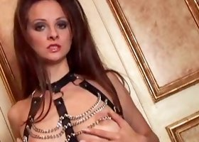 Busty brunette Sanja poses in sexy chained bra