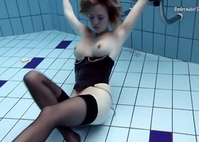 European solo babe in nylon stockings displaying her nice ass in the pool