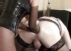 Sissy gets a prostate massage with both Domme's arms elbow-deep