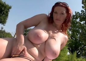 Redhead is licking her own nipples