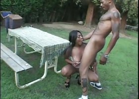 Black babe with huge natural tits is getting fucked hard in the backyard