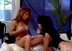 Lustful Isis Nile and Leena suck a dildo and start to toy their pussies
