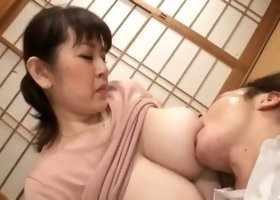 japenese sucks stepmom's tits while she jerks him off