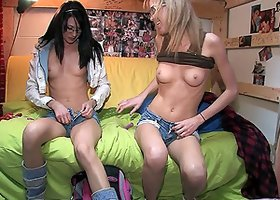 Stunning cowgirls in glasses stroking their shaved cuts with dildos