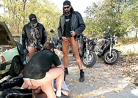 A biker gang is fucking this juicy blondie