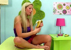 A naughty girl with a food fetish lays back and fucks a banana