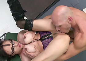 Cytherea gets banged on a desk after sucking and titfucking a cock