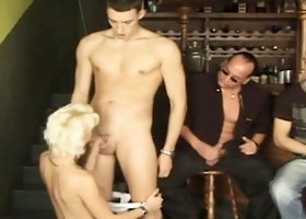 Sultry barmaid with perky tits has a gang of studs punishing her holes