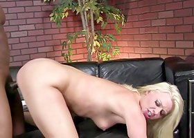 Blonde sucks a big black cock and gets her pussy fucked