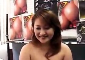 Curvaceous Oriental cutie peels off her clothes and reveals