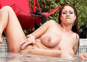 Curvy brunette, Eva Notty, wearing bikini, fingers her pussy in a pool